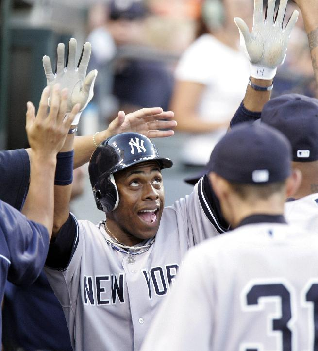 In this Aug. 6, 2012 file photo, New York Yankees' Curtis Granderson celebrates in the dugout after scoring on a double by Robinson Cano in the fifth inning of a baseball game against the Detroit Tigers, in Detroit. A person familiar with the situation says free-agent outfielder Granderson and the New York Mets have agreed to a $60 million, four-year contract. The person spoke to The Associated Press on condition of anonymity Friday, Dec. 6, 2013,  because the deal was pending a physical and no announcement had been made