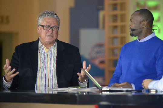 MLB Network analyst Harold Reynolds, right, listens as Pittsburgh Pirates manager Clint Hurdle answers a question during a televised interview at the baseball's winter meetings in Lake Buena Vista, Fla., Tuesday, Dec. 10, 2013