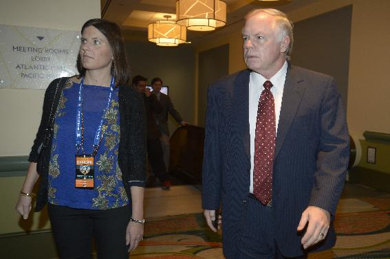 Baltimore Orioles manager Buck Showalter, right, heads to a managers reception at baseball's winter meetings in Lake Buena Vista, Fla., Wednesday, Dec. 11, 2013