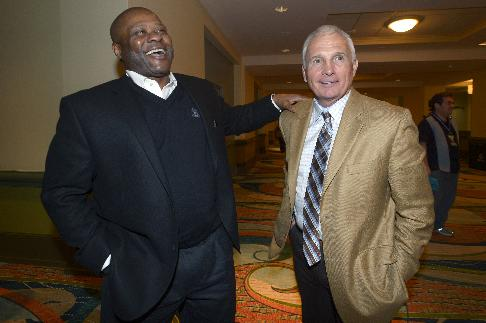 Seattle Mariners manager Lloyd McClendon, left, and New York Mets manager Terry Collins share a laugh at baseball's winter meetings in Lake Buena Vista, Fla., Wednesday, Dec. 11, 2013