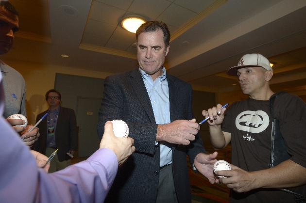 Boston Red Sox manager John Farrell, center, signs autographs at baseball's winter meetings in Lake Buena Vista, Fla., Wednesday, Dec. 11, 2013