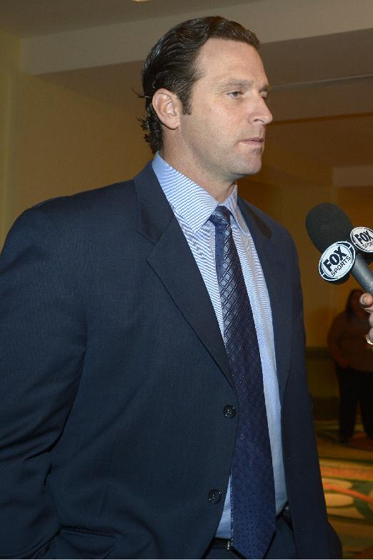 St. Louis Cardinals manager Mike Matheny answers a question from a reporter at baseball's winter meetings in Lake Buena Vista, Fla., Wednesday, Dec. 11, 2013