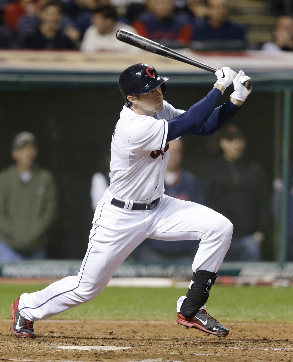 In this Sept. 25, 2013 file photo, Cleveland Indians' Drew Stubbs hits an RBI-sacrifice fly off Chicago White Sox starting pitcher Dylan Axelrod in the sixth inning of a baseball game, in Cleveland. The Indians have acquired left-hander Josh Outman from Colorado for outfielder Drew Stubbs, Wednesday, Dec. 18, 2013