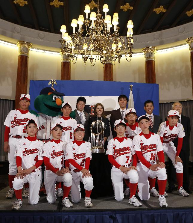 U.S. Ambassador to Japan Caroline Kennedy, center, Red Sox pitchers Junichi Tazawa, center left, Koji Uehara, center right, Red Sox mascot Wally and players of Tokyo's Musashi Fuchu Little League Baseball World Champions, pose for photos with the World Series trophy at the U.S. embassy in Tokyo, Tuesday, Jan. 21, 2014