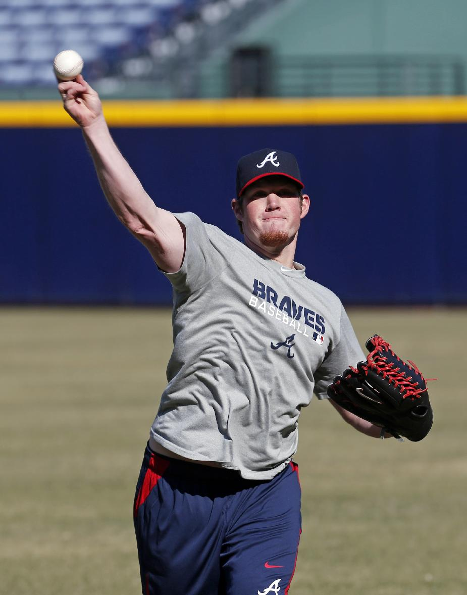 Atlanta Braves closer Craig Kimbrel throws during the first day of voluntary workouts for pitchers Monday, Jan. 27, 2014, in Atlanta