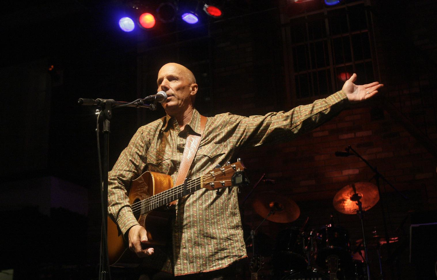 In this March 11, 2010 file photo, San Francisco Giants third base coach Tim Flannery plays music at Jake Peavy's Woodjock 2010 A Big League Jam Fest in Scottsdale, Ariz. Flannery, the San Francisco Giants' third-base coach and musician, presented the family of Bryan Stow with $96,000 during the weekend to help with his care as he continues to deal with traumatic injuries and brain damage from being severely beaten outside Dodger Stadium on opening day 2011