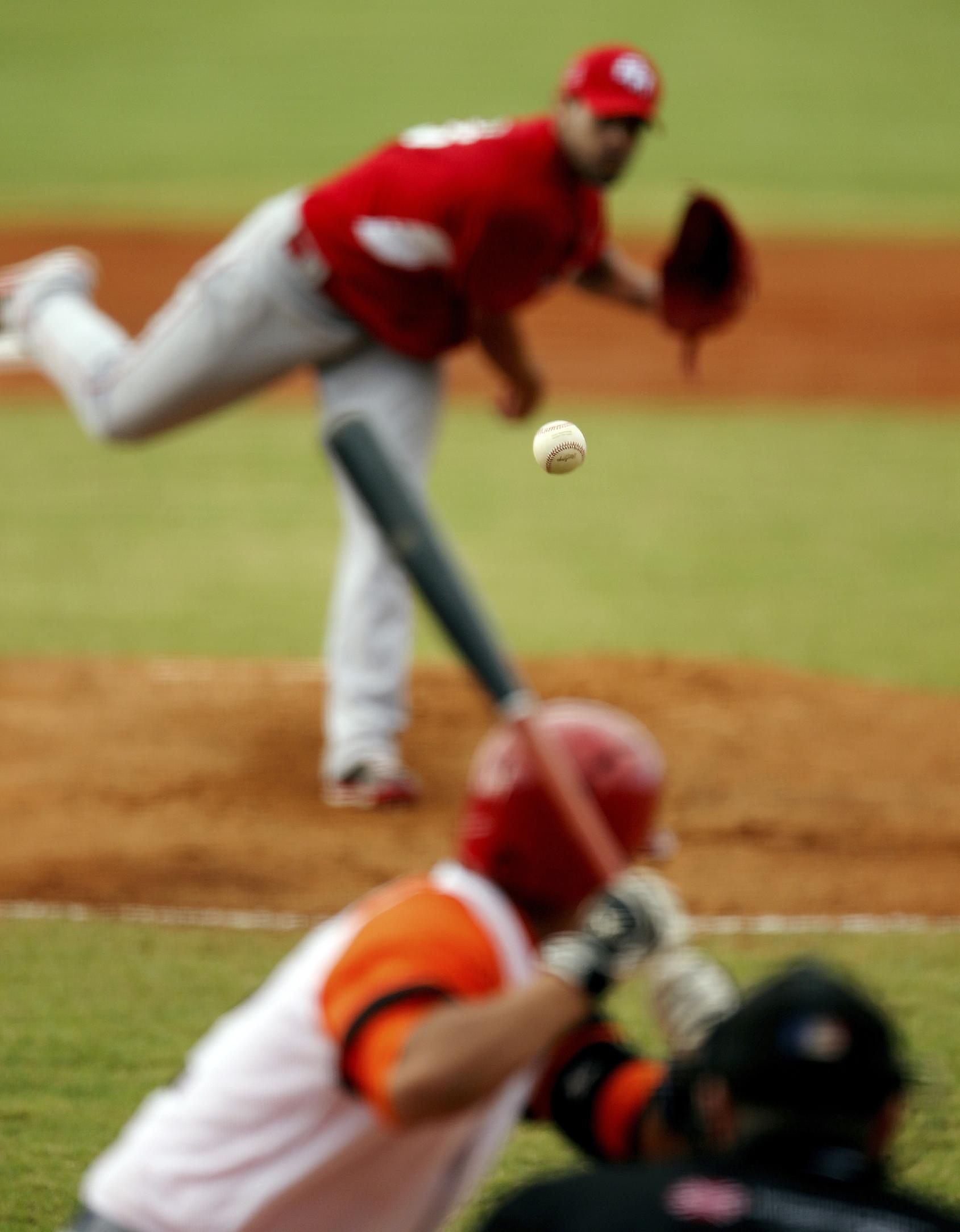 Puerto Rico pitcher Joel Pinero pitches to Cuba infielder Yulieski Gourriel in the first inning of their Caribbean Series baseball game in Porlamar, Venezuela, Tuesday, Feb. 4, 2014