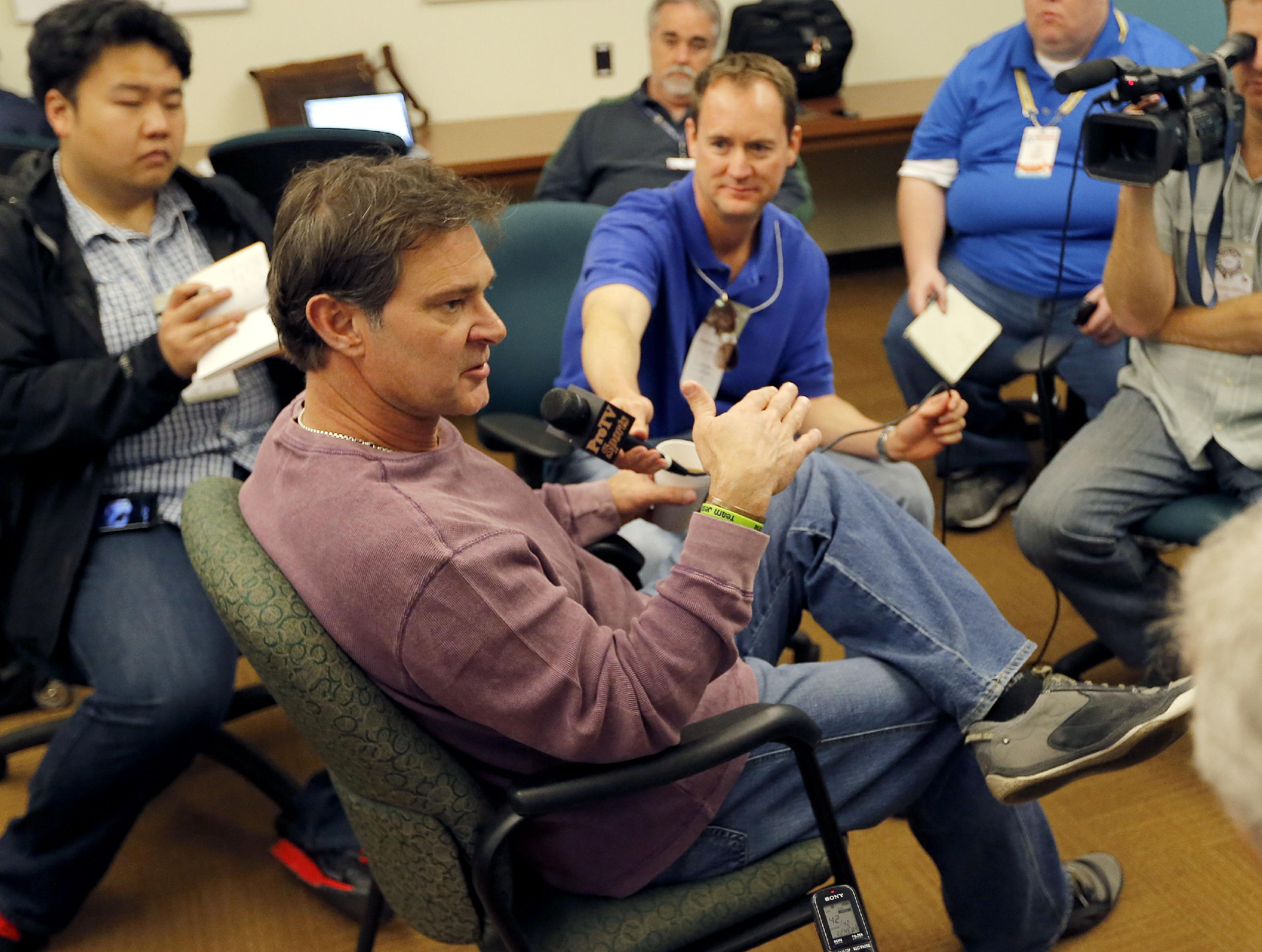 Los Angeles Dodgers manager Don Mattingly speaks to reporters, Saturday, Feb. 8, 2014, in Glendale, Ariz. The Dodgers first spring training baseball practice begins Sunday
