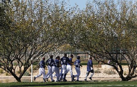 A group of Los Angeles Dodgers pitchers run during spring training baseball practice Sunday, Feb. 9, 2014, in Glendale, Ariz