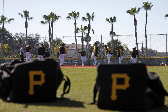 Pittsburgh Pirates everyday players stretch in the outfield before taking part in a workout at baseball spring training in Bradenton, Fla., Sunday, Feb. 16, 2014