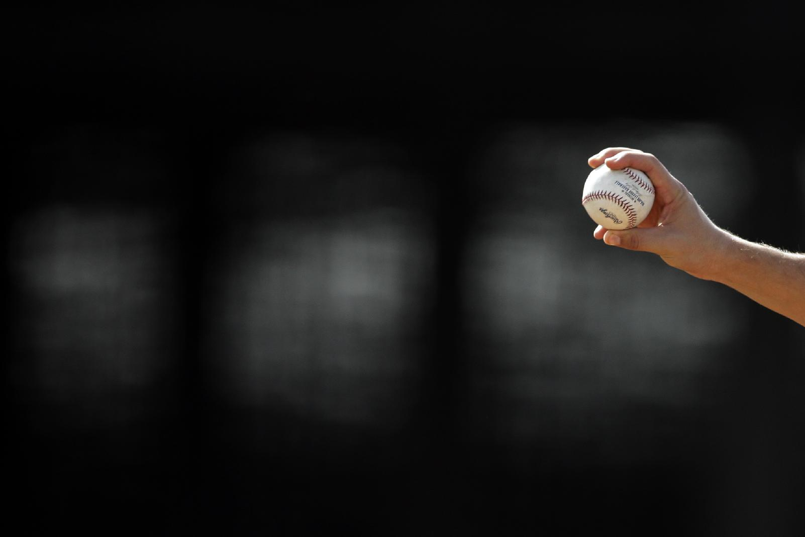 Colorado Rockies invitee pitcher Christian Bergman reaches back with the ball as he throws during baseball spring training, Friday, Feb. 21, 2014, in Scottsdale, Ariz