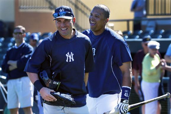 New York Yankees' Jacoby Ellsbury, left, is greeted by Detroit Tigers' Victor Martinez as he arrives for an exhibition spring training baseball game in Lakeland, Fla.,  Friday, Feb. 28, 2014