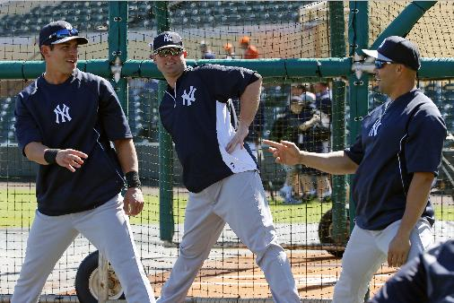New York Yankees' Jacoby Ellsbury, left, Brian McCann, center, and Carlos Beltran stretch before an exhibition spring training baseball game against the Detroit Tigers in Lakeland, Fla.,  Friday, Feb. 28, 2014