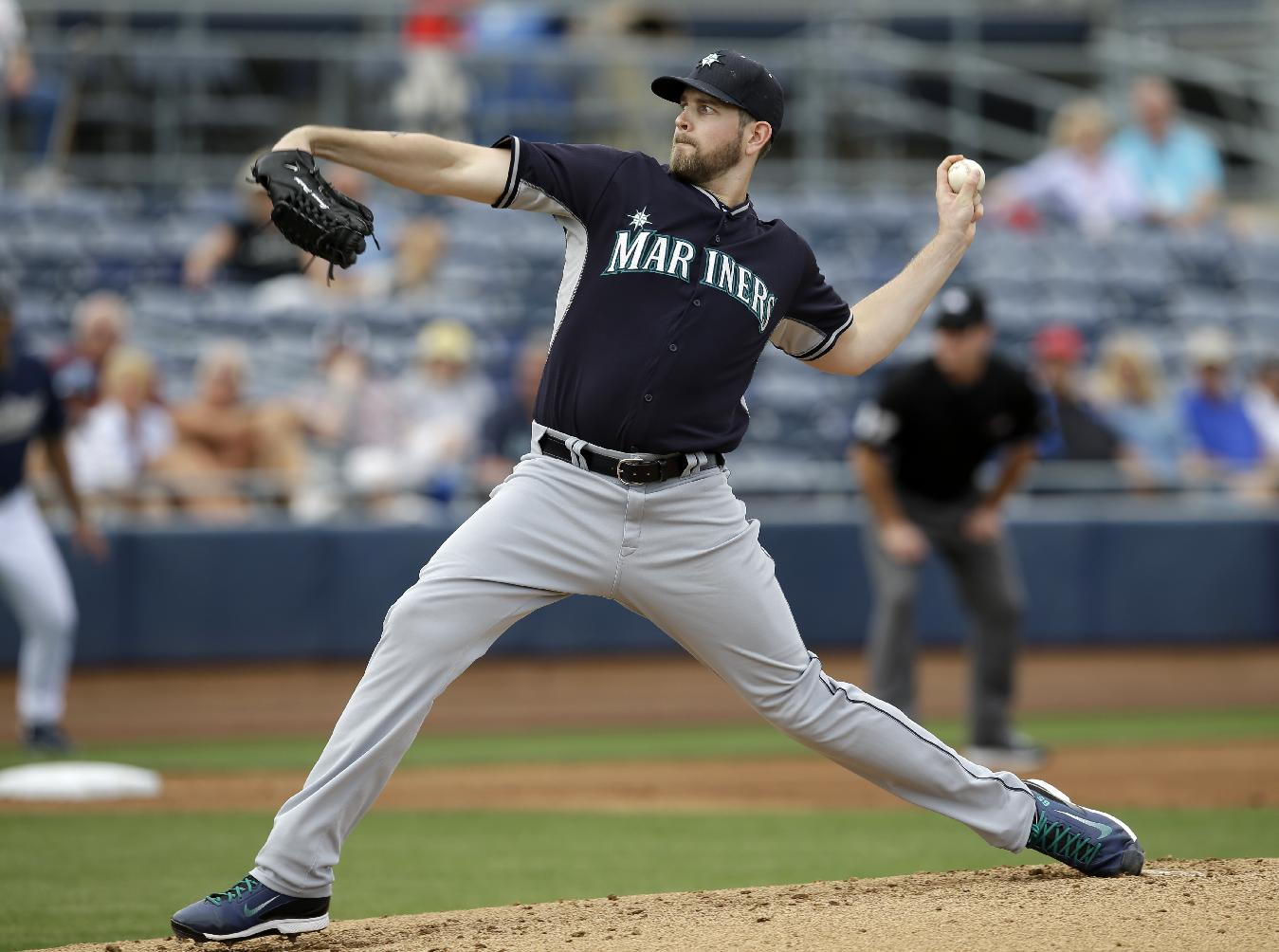 Seattle Mariners' James Paxton delivers to the San Diego Padres in the first inning of an exhibition baseball game on Friday Feb. 28, 2014, in Peoria, Ariz