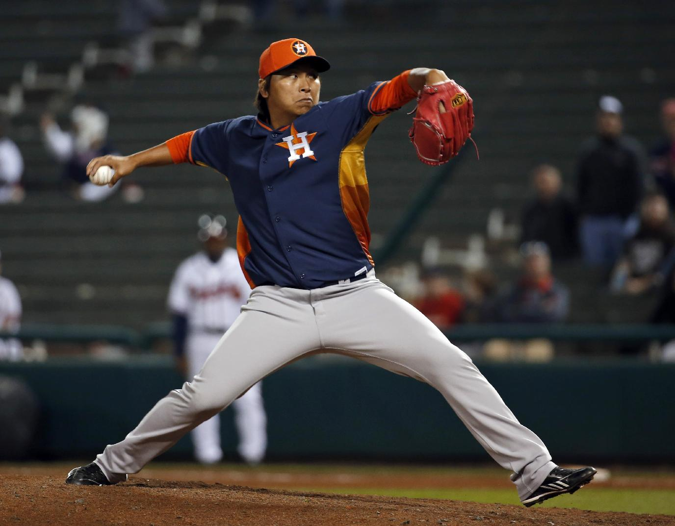 Houston Astros pitcher Chia-Jen Lo throws in the ninth inning of an exhibition baseball game against the Atlanta Braves, Friday, Feb. 28, 2014, in Kissimmee, Fla. The Astros won 7-5