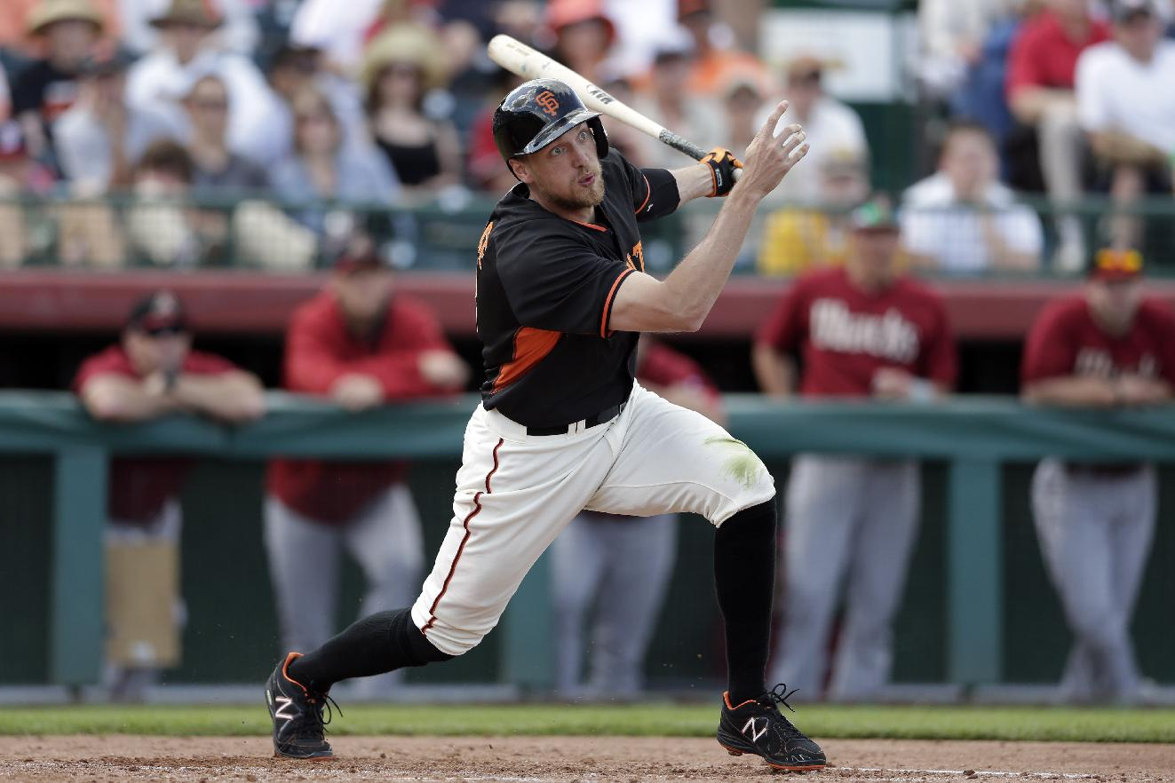 San Francisco Giants' Hunter Pence watches a foul ball during the third inning of a spring training baseball game against the Arizona Diamondbacks on Sunday, March 2, 2014, in Scottsdale, Ariz