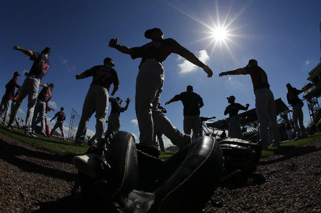 The Boston Red Sox warm up before an exhibition spring training baseball game against the Pittsburgh Pirates in Bradenton, Fla., Monday, March 3, 2014