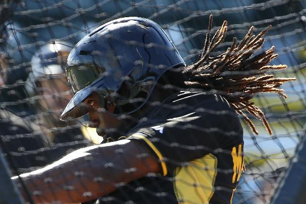 Pittsburgh Pirates' Andrew McCutchen hits during batting practice before  an exhibition spring training baseball game  against the Boston Red Sox in Bradenton, Fla., Monday, March 3, 2014