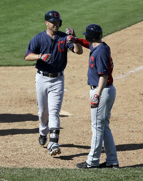 Cleveland Indians' Ryan Raburn, left, is congratulated on his two-run home run that scored Elliot Johnson, right, off a pitch from Seattle Mariners relief pitcher Lucas Luetge in the seventh inning of a spring training baseball game, Wednesday, March 5, 2014, in Peoria, Ariz