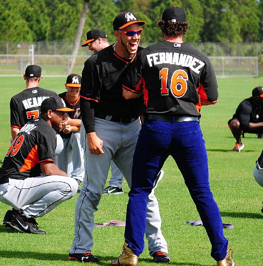 Miami Marlins catcher Jarrod Saltalamacchia, right, raided teammate Jose Fernandez's, left,  locker and decided to wear Fernandez's jersey, purple jeans and gold high top sneakers to the team's morning stretch during a spring training baseball workout, Friday, March 7, 2014, in Jupiter, Fla