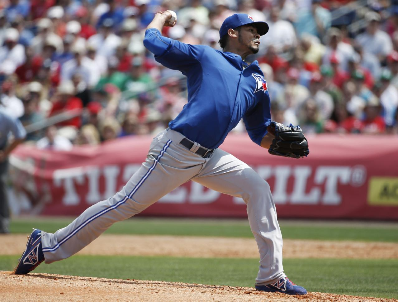 Toronto Blue Jays starting pitcher Esmil Rogers delivers in the second inning of a spring exhibition baseball game against the Philadelphia Phillies in Clearwater, Fla., Thursday, March 20, 2014. The Blue Jays won 3-1