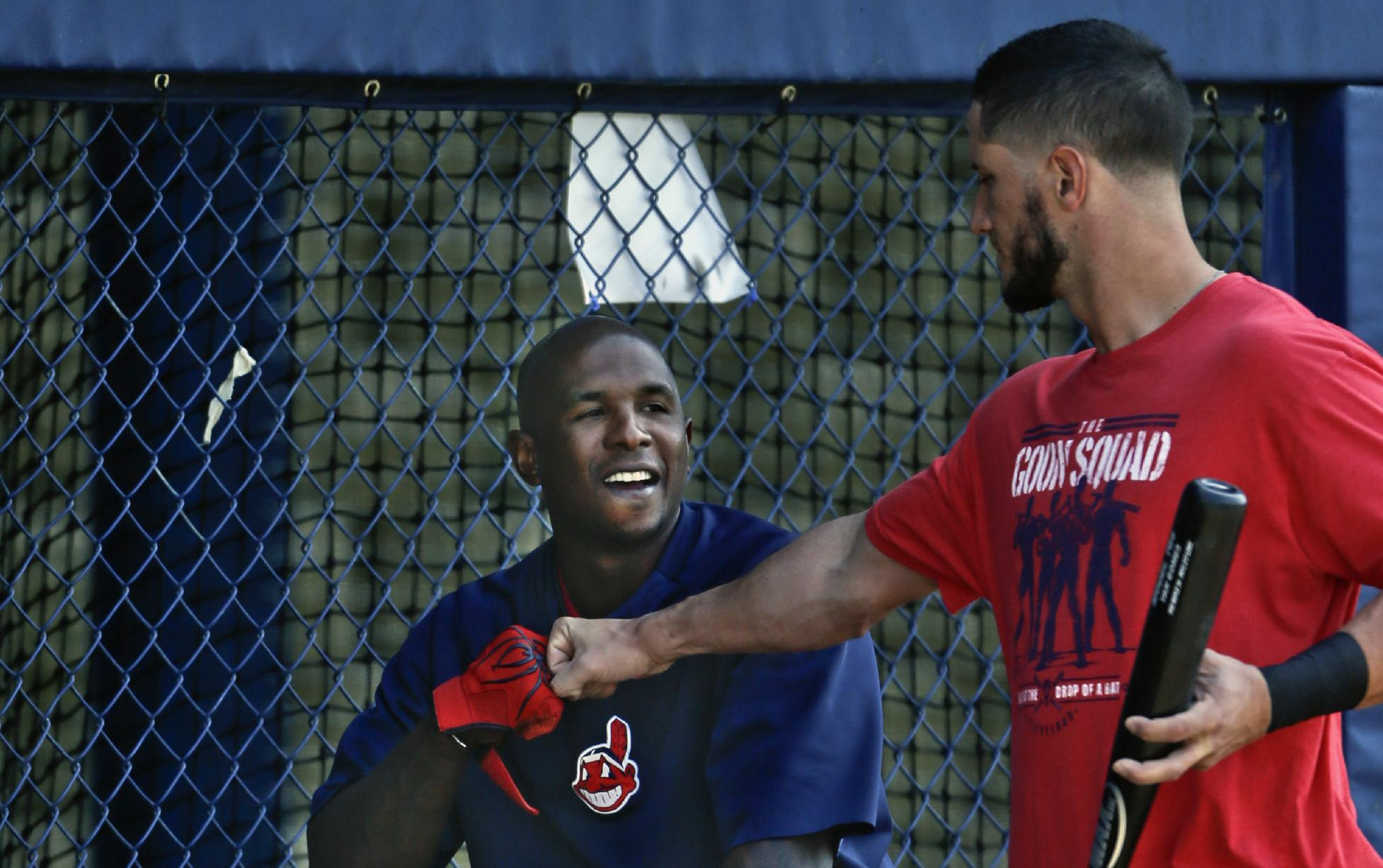 Cleveland Indians catcher Yan Gomes,  right, knocks knuckles with right fielder Nyjer Morgan before a spring exhibition baseball game on Friday, March 28, 2014, in San Diego