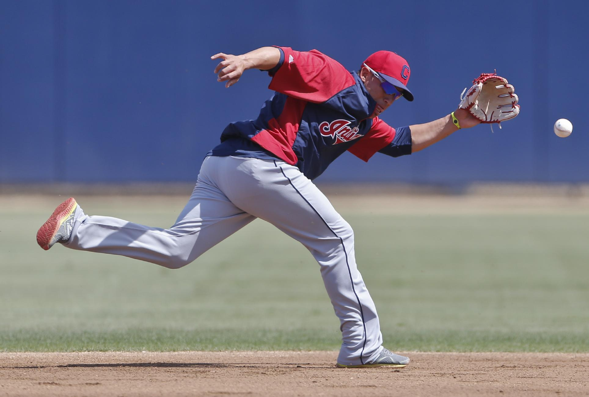 Cleveland Indians shortstop Asdrubal Cabrera goes after a ball behind second during fielding drills prior to a spring training exhibition baseball game  against the San Diego Padres Saturday, March 29, 2014, in San Diego