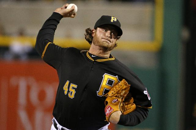 Pittsburgh Pirates starting pitcher Gerrit Cole delivers during the first inning of a baseball game against the St. Louis Cardinals in Pittsburgh on Friday, April 4, 2014
