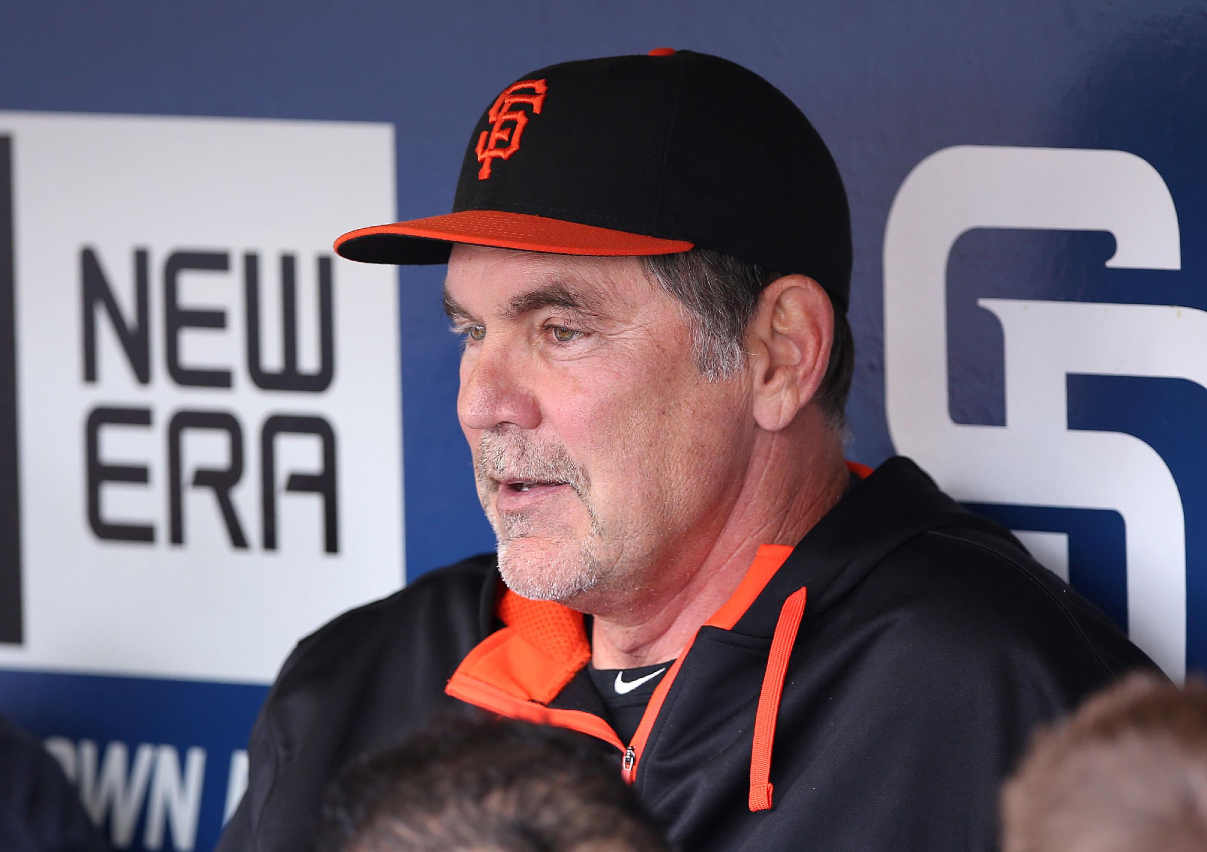 San Francisco Giants manager Bruce Bochy talks with members of the media before a baseball game against the San Diego Padres, Friday, April 18, 2014, in San Diego