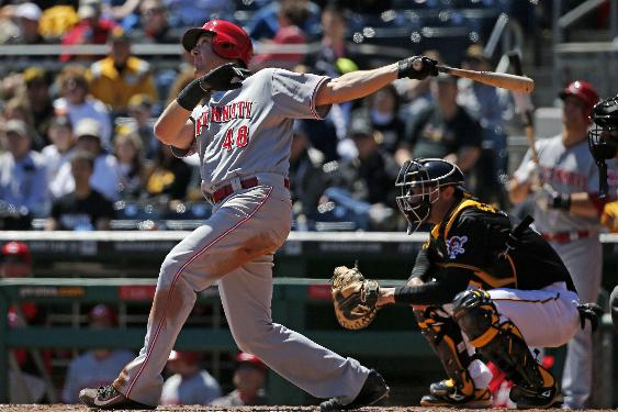 Cincinnati Reds' Ryan Ludwick, left, pops out in the fourth inning of a baseball game against the Pittsburgh Pirates in Pittsburgh, Thursday, April 24, 2014. The Reds won 2-1