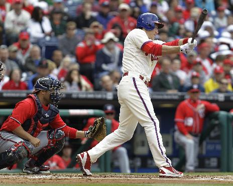 Philadelphia Phillies' Chase Utley, right, connects on an RBI-single to bring home Jimmy Rollins in the first inning of a baseball game against the Washington Nationals, Sunday, May 4, 2014, in Philadelphia