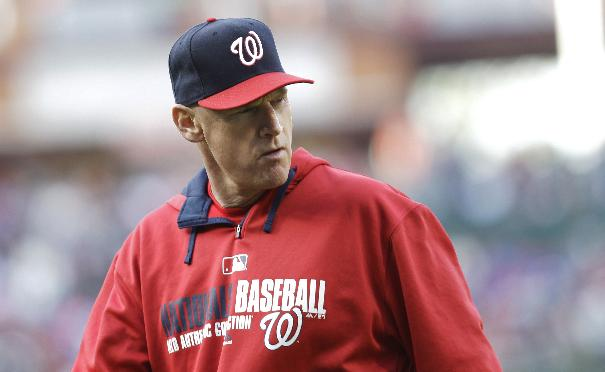 Washington Nationals manager Matt Williams walks back to the dugout after removing pitcher Gio Gonzalez from the mound in the eighth inning of a baseball game against the Philadelphia Phillies, Sunday, May 4, 2014, in Philadelphia. The Phillies won 1-0
