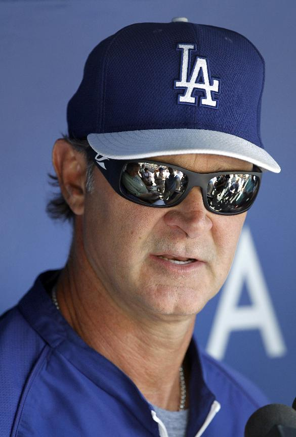 Los Angeles Dodgers manager Don Mattingly talks with the media in the dugout before a baseball game against the San Francisco Giants, Saturday, May 10, 2014, in Los Angeles