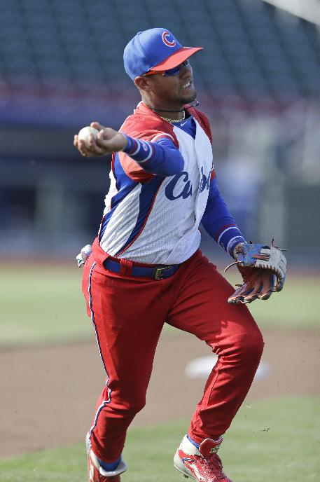 In this July 19, 2013 file photo, Cuba third baseman Yulieski Gourriel warms up prior to an exhibition baseball game against the United States in Papillion, Neb. The third baseman signed a contract Monday, May 12, 2014, to join Japan's Yokohama Bay Stars