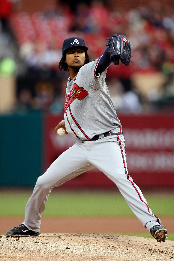 Atlanta Braves starting pitcher Ervin Santana  throws during the first inning of a baseball game against the St. Louis Cardinals Friday, May 16, 2014, in St. Louis