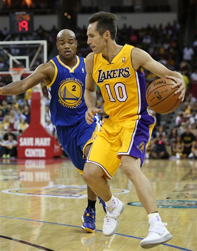 Steve Nash had five points and three assists in his preseason debut with the Lakers. (AP)