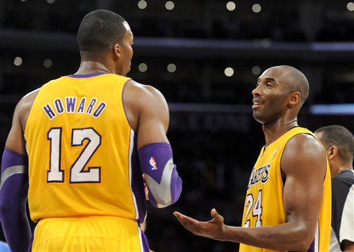 Dwight Howard and Kobe Bryant watched the Lakers get off to a tough start to the season. (AP)