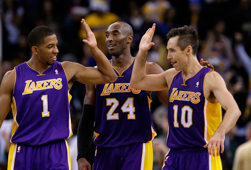 Steve Nash celebrates with Darius Morris and Kobe Bryant during the Lakers' win over the Warriors. (AP)