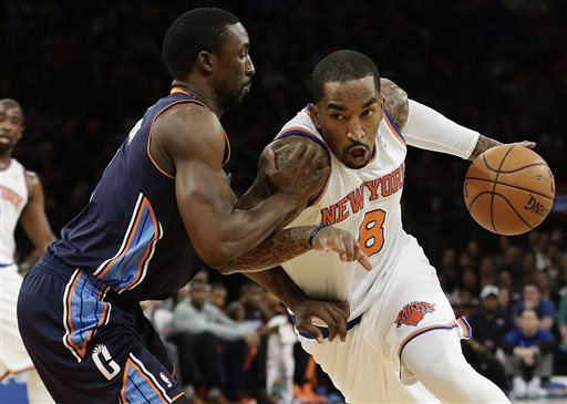 In this March 29, 2013 file photo, New York Knicks' J.R. Smith, right, drives past Charlotte Bobcats' Ben Gordon during the first half of an NBA basketball game in New York. A person with knowledge of the voting results tells The Associated Press that J.R. Smith has won the NBA's Sixth Man of the Year award.  The Knicks have called an afternoon news conference, Monday, April 22, 2013,  at which Smith will be given the award, the person tells the AP on condition of anonymity because no announcement has been made