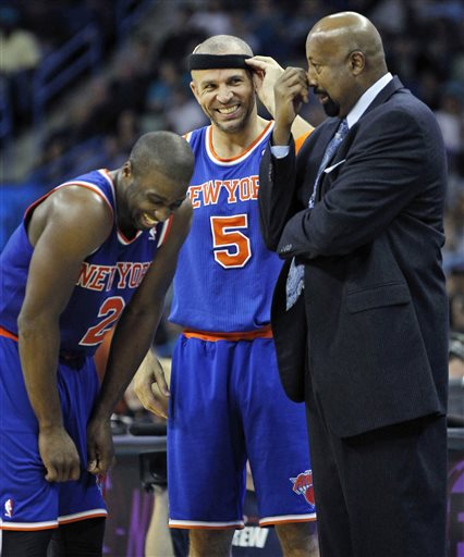 In this Nov. 20, 2012, file photo, New York Knicks head coach Mike Woodson,right, laughs with point guards Jason Kidd (5) and Raymond Felton (2) during a break in the second half of an NBA basketball game against the New Orleans Hornets in New Orleans. Kidd is the recipient of the Joe Dumars Trophy presented to the 2012-13 NBA Sportsmanship Award winner, the NBA announced Tuesday, April 30, 2013.  