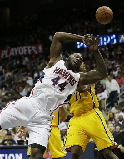 Atlanta Hawks power forward Ivan Johnson (44) loses the ball as Indiana Pacers power forward David West (21) defends during the second half of an NBA first-round playoff basketball game in Atlanta, Friday, May 3, 2013