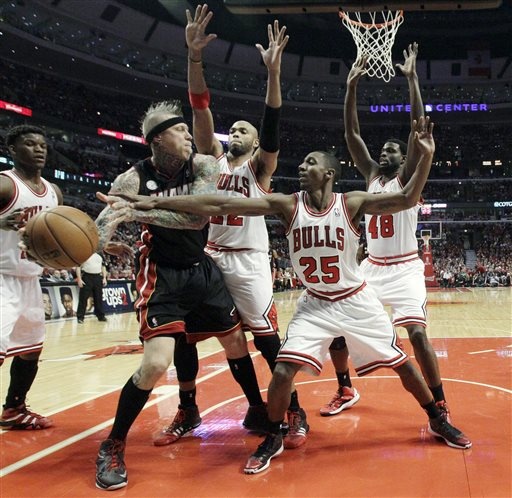Miami Heat forward Chris Andersen (11) is defended by Chicago Bulls' Taj Gibson (22), Marquis Teague (25) and Nazr Mohammed (48) after grabbing a rebound against Chicago Bulls defense during the first half of Game 4 of an NBA basketball playoffs Eastern Conference semifinal on Monday, May 13, 2013, in Chicago
