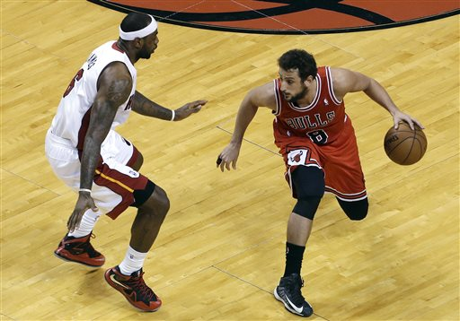 Chicago Bulls' Marco Belinelli (8) looks to move past Miami Heat's LeBron James (6) during the first half of Game 5 of an NBA basketball Eastern Conference semifinal series, Wednesday, May 15, 2013, in Miami