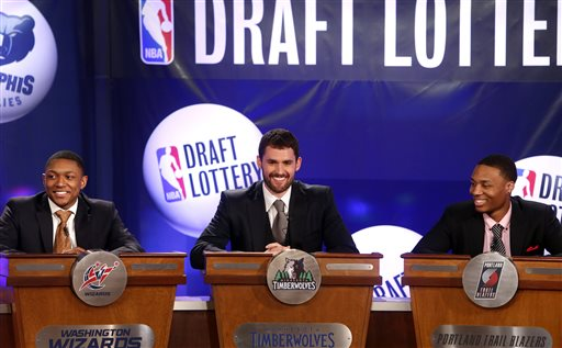 NBA basketball players, from left, Washington Wizards' Bradley Beal, Minnesota Timberwolves' Kevin Love and Portland Trailblazers' Damian Lillard represent their teams during the NBA draft lottery, Tuesday, May 21, 2013 in New York