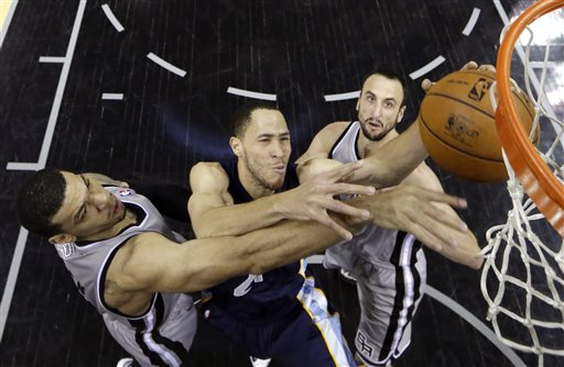 Memphis Grizzlies' Tayshaun Prince goes up for a shot against San Antonio Spurs' Danny Green, left, and Manu Ginobili, of Argentina, during the first half in Game 2 of the Western Conference finals NBA basketball playoff series, Tuesday, May 21, 2013, in San Antonio