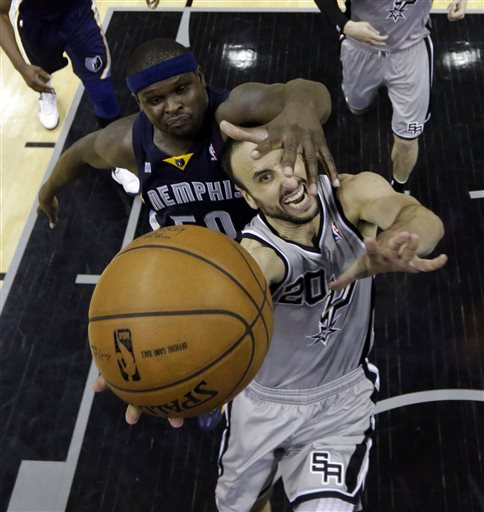 San Antonio Spurs' Manu Ginobili (20), of Argentina, is defended by Memphis Grizzlies' Zach Randolph, left, as he drives to the basket during the second half in Game 2 of a Western Conference Finals NBA basketball playoff series, Tuesday, May 21, 2013, in San Antonio