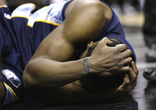 Memphis Grizzlies' Tony Allen holds his head after he was fouled by San Antonio Spurs' Manu Ginobili during the second half in Game 2 of a Western Conference Finals NBA basketball playoff series, Tuesday, May 21, 2013, in San Antonio