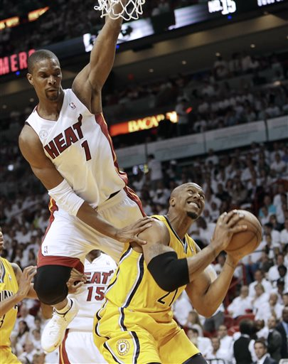 Miami Heat center Chris Bosh (1) pressures Indiana Pacers forward David West (21) during the first half of Game 1 in their NBA basketball Eastern Conference finals playoff series, Wednesday, May 22, 2013 in Miami