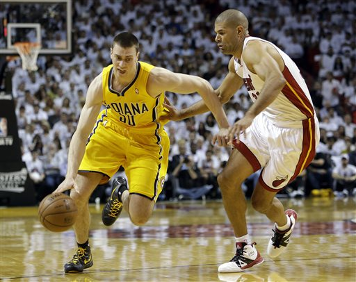 Indiana Pacers forward Tyler Hansbrough (50) drives against Miami Heat forward Shane Battier (31) during the first half of Game 1 in their NBA basketball Eastern Conference finals playoff series, Wednesday, May 22, 2013 in Miami