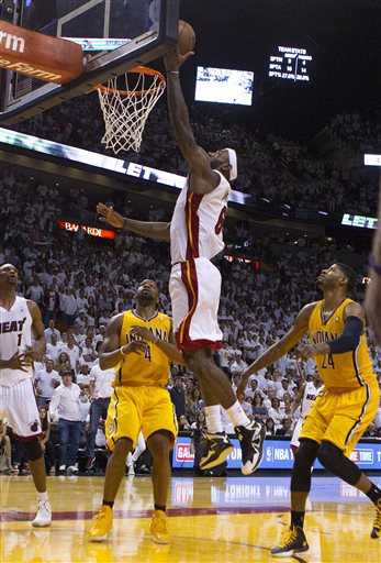 LeBron James goes in for the game winner in overtime as the Miami Heat host the Indiana Pacers for game 1 of the Eastern Conference Finals at the American Airlines Arena in Miami, Florida May 22, 2013